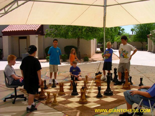 Children Play Outdoor Wooden Chess Games